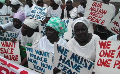 Liberian women demonstrate at the American Embassy in Monrovia at the height of the civil war, 2003